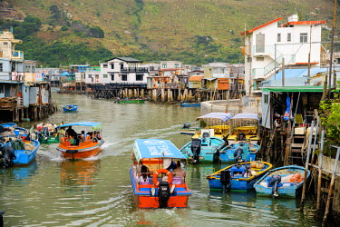 HMS1826733 China, Hong Kong, Lantau Island, Tai O, fishermen's on piles traditional village, sailing boat on an arm of the sea in the middle of houses