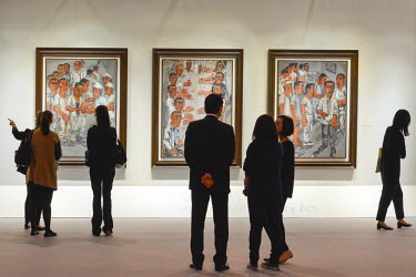 HMS1826753 China, Hong Kong, Hong Kong Island, Hong Kong Convention Center, exhibition of contemporary art from Christie's, visitors in front of a triptych of the Chinese painter Zeng Fanzhi