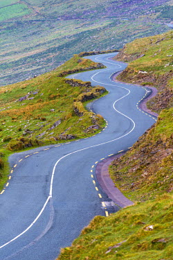 Connor pass, Dingle peninsula, County Kerry, Munster province, Ireland, Europe. Bending road leading to the pass.