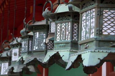 AS15PDY0143 Smaller metal and gold lanterns are representations of their ancient stone siblings. Kasuga-Taisha Shrine in Nara, Japan.