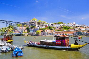 POR8879AW Portugal, Douro Litoral, Porto. Tourists boats on Douro River in the UNESCO listed Ribeira district of Porto.