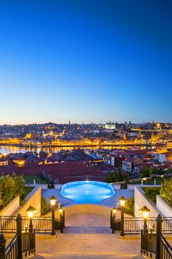 POR8904AW Portugal, Douro Litoral, Porto. Dusk view towards the old town of Porto and the Ribeira district from The Yeatman Hotel in Vila Nova De Gaia.