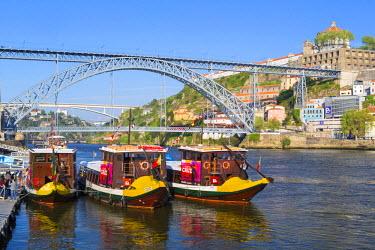 POR8923AW Portugal, Douro Litoral, Porto. Tourists boats on Douro River in the UNESCO listed Ribeira district of Porto.