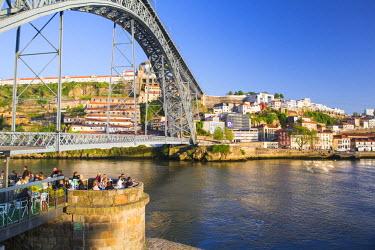 POR8925AW Portugal, Douro Litoral, Porto. Dom Luis I Bridge and the view to Vila Nova De Gaia from the Ribeira district of Porto.