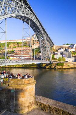 POR8926AW Portugal, Douro Litoral, Porto. Dom Luis I Bridge and the view to Vila Nova De Gaia from the Ribeira district of Porto.