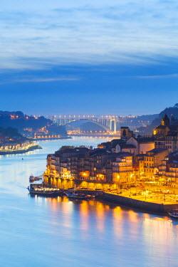 POR8929AW Portugal, Douro Litoral, Porto. Dusk in the UNESCO listed Ribeira district of Porto.
