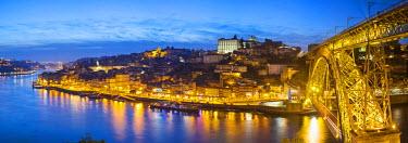 POR8930AW Portugal, Douro Litoral, Porto. Dusk in the UNESCO listed Ribeira district.