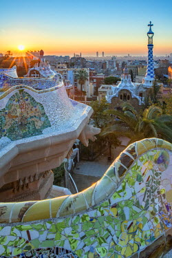 CLKFV39010 Park Guell with city skyline behind at sunrise, Barcelona, Catalonia, Spain