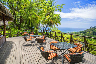 CR33247 Costa Rica, Puntarenas Province, Osa Peninsula, Lapa Rios.  A deck of a tourist lodge overlooking the Pacific Ocean.
