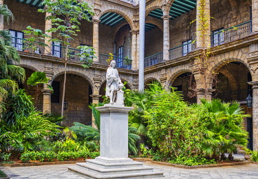 CUB1433 Cuba, Havana, Habana Vieja, Plaza de Armas.  The Museo de la Ciudad, the City Museum, occupies a very fine old building of baroque architecture with a Carrara marble statue of Christopher Columbus in...
