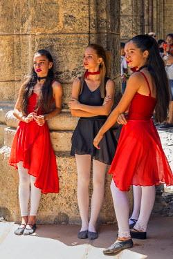 CUB1462 Cuba, Havana, Plaza de Armas, Habana Vieja.  Smart young girls wait to participate in a public dancing display at Plaza de Armas, Havana�s oldest square.