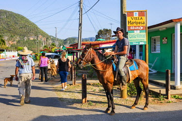 CUB1483 Cuba, Pinar Del Rio Province, Vinales, Parc Nacional Vinales.  A typical street scene in laid-back, rural Vinales which relies on agriculture and tourism for its existence.