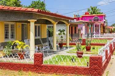CUB1491 Cuba, Pinar Del Rio Province, Vinales, Parc Nacional Vinales.  A typical street of colourful single-storied houses with neat gardens in laid-back, rural Vinales. Visitors can book to stay in several o...