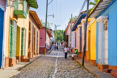 CUB1509 Cuba, Sancti Spiritus Province, Trinidad.  Colourful houses line either side of a cobblestone street in the historic part of Trinidad which was founded early in the 16th century.