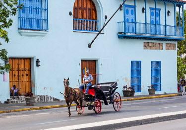 CUB1540 Cuba, Havana, Habana Vieja. A horse and carriage in the streets of Havana.