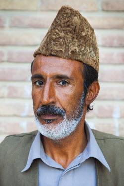 IR01160 Iran, Southeastern Iran, Kerman, End to End Bazaar, Baluchi man in traditional clothes