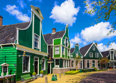 NLD0132AW Netherlands, North Holland, Zaandam. First Albert Heijn supermarket (left) and historic buildings in the village of Zaanse Schans.