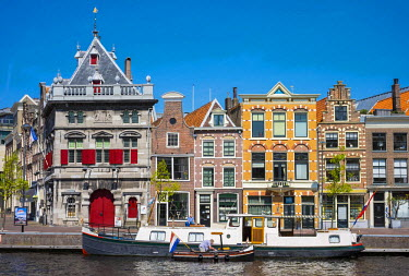 NLD0198AW Netherlands, North Holland, Haarlem. Buildings along the Spaarne River.