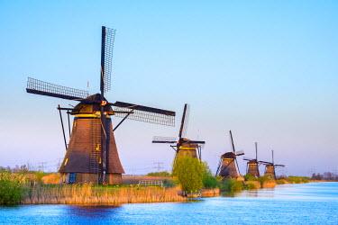 NLD0238AWRF Netherlands, South Holland, Kinderdijk, UNESCO World Heritage Site. Historic Dutch windmills on the polders at sunset.