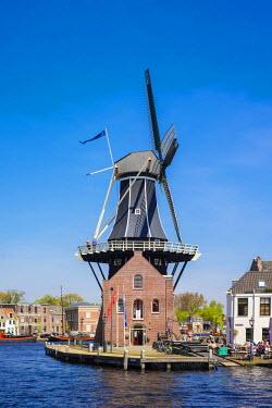 NLD0269AWRF Netherlands, North Holland, Haarlem. Windmill De Adriaan on the Spaarne River.