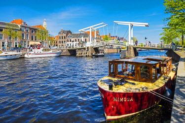 NLD0271AWRF Netherlands, North Holland, Haarlem. Gravestenenbrug drawbridge and boats on the Spaarne River.
