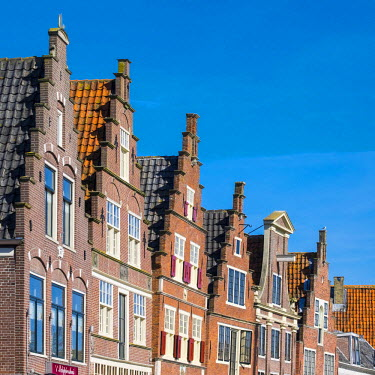 NLD0168AW Netherlands, North Holland, Hoorn. Historic building facades along the Binnenhaven harbor quay.