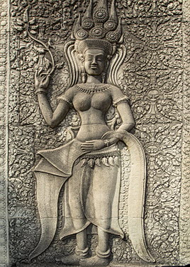 CMB1532AW Asia, Cambodia, Siem Reap, Angkor, Angkor wat, temple carving on the side of Angkor wat