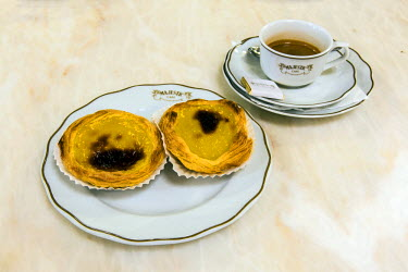 POR9004AW Cup of coffee and pastel de nata pastries served at Majestic Cafe, Porto, Portugal