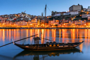 POR9027AWRF Traditional Rabelo boat designed to carry wine down Douro river with city skyline behind, Porto, Portugal