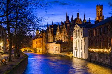 BE049RF Belgium, Bruges, canalside buildings and Belfort Tower, dusk