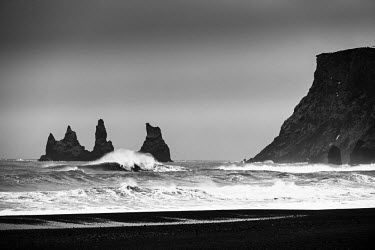 ICE3813 Volcanic black sand beach and sea stacks, Vik, South Iceland