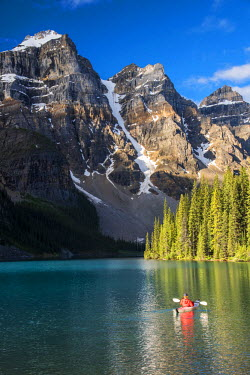 CAN2983AW Canoeist paddling on Moraine Lake, Banff National Park, Alberta, Canada