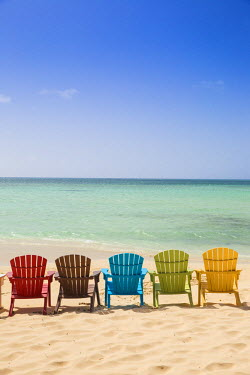 AA014RF Caribbean, Netherland Antilles, Aruba, A row of colourful wooden deck chairs on Palm Beach