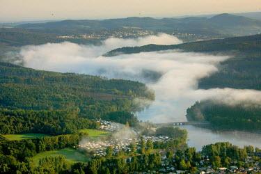 IBLBLO00975784 Aerial view of forested area, wafts of mist, Sorpesee, Sundern, Amecke, Illingheim, Sauerland, North Rhine-Westphalia, Germany