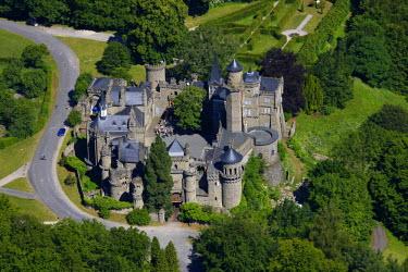 IBLBLO01658202 Aerial view of Loewenburg castle, Bergpark Wilhelmshoehe park, Kassel, Hesse, Germany