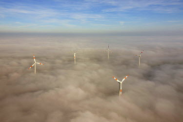 IBLBLO02094714 Aerial view of wind turbines sticking out from cloud cover, Kyffhaeuser district, Thuringia, Germany