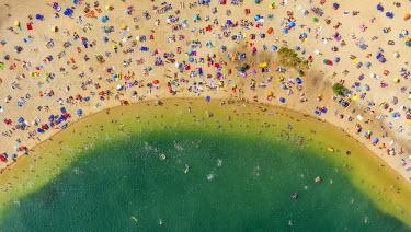 IBLBLO03651975 Aerial view of sandy beach at Silbersee II lake with people swimming and sunbathing, Sythen, Haltern am See, North Rhine-Westphalia, Germany