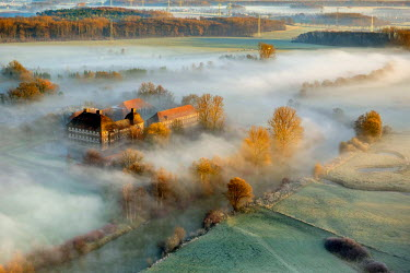 IBLBLO03801873 Aerial view of Schloss Oberwerries moated castle, morning fog above the Lippe river, Lippeauen, Hamm, Ruhr area, North Rhine-Westphalia, Germany