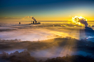 IBLBLO03801937 Aerial view of sunrise, morning mist above the Lippe river, gas turbine power plant Trianel power plant, Hamm, Ruhr area, North Rhine-Westphalia, Germany