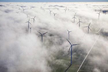 IBLBLO03805840 Wind turbines covered by low clouds, blue sky, Aerial view of Marsberg, Sauerland region, North Rhine-Westphalia, Germany