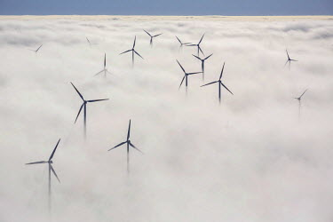 IBLBLO03805845 Wind turbines covered by low clouds, blue sky, Aerial view of Marsberg, Sauerland region, North Rhine-Westphalia, Germany