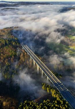 IBLBLO03805949 Aerial view of A46 motorway bridge, low clouds, Meschede, Sauerland, North Rhine-Westphalia, Germany