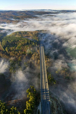 IBLBLO03805950 Aerial view of A46 motorway bridge, low clouds, Meschede, Sauerland, North Rhine-Westphalia, Germany