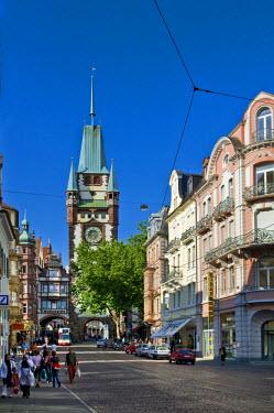 IBLDJS01424617 Martinstor gate and Kaiser-Josef-Strasse street, Freiburg, Baden-Wuerttemberg, Germany