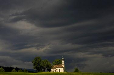 IBLSEI01195148 Little chapel in front of stormy sky, Weilheim, Upper Bavaria, Bavaria, Germany