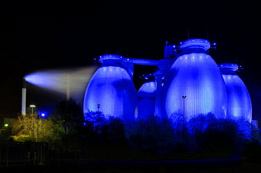 IBLSEI01925404 Digester towers illuminated at night, Bochum, North Rhine-Westphalia, Germany