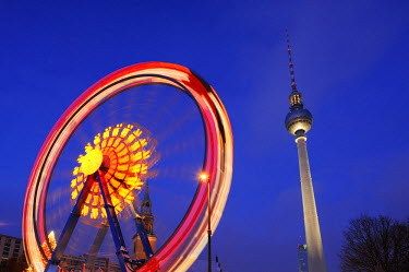 IBLSHU01793660 Ferris wheel in motion with TV Tower, Alexanderplatz, Berlin, Germany