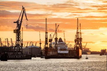 IBLVCH03763147 Cruise ship in a dry dock at sunset, Port of Hamburg, Hamburg, Hamburg, Germany