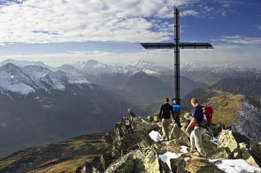 IBLDJS02454937 Climbers on Bettmerhorn Mountain, overlooking the Rhone Valley and the Pennine Alps, Bettmeralp, Valais, Switzerland