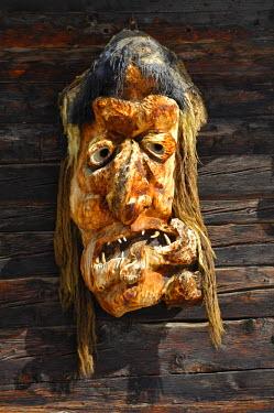 IBLGUF00324712 Traditional wooden mask made of Swiss pine wood, Wiler, Loetschental, Valais, Switzerland
